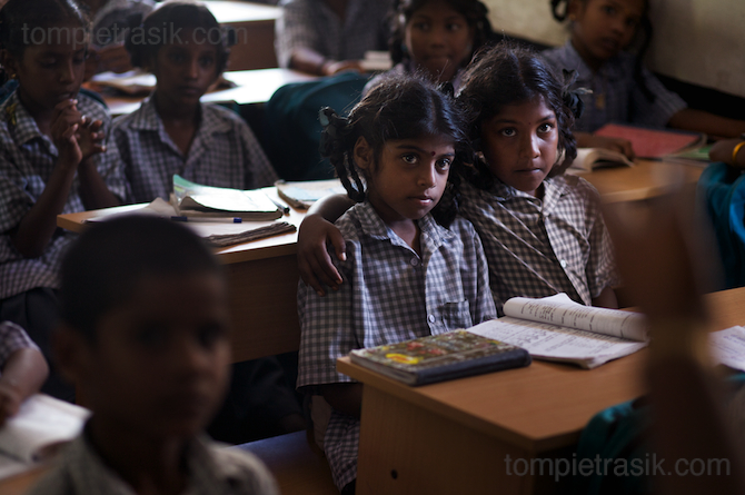Pupils at Thalanguda government school listen to their teacher. Tamil Nadu, India © Tom Pietrasik 2008