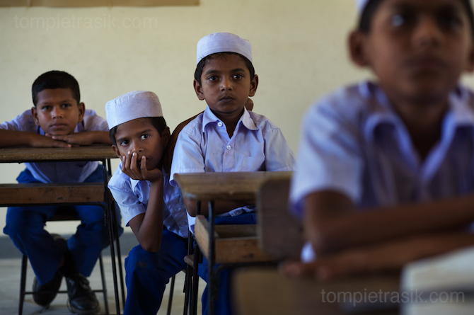 Pupils in their classroom at a state-run school in Akkarapattu. Ampara District, Sri Lanka © Tom Pietrasik 2008
