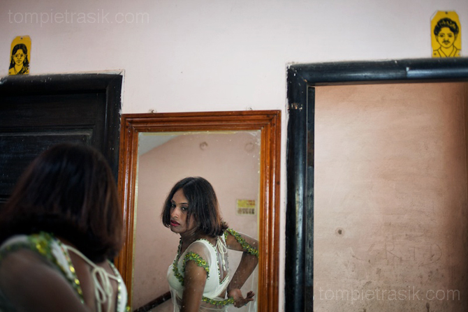 An Aravani or transgender woman makes adjustments to her sari. Transexuals are the most visible group within India's gay community. Tamil Nadu, India © Tom Pietrasik 2009
