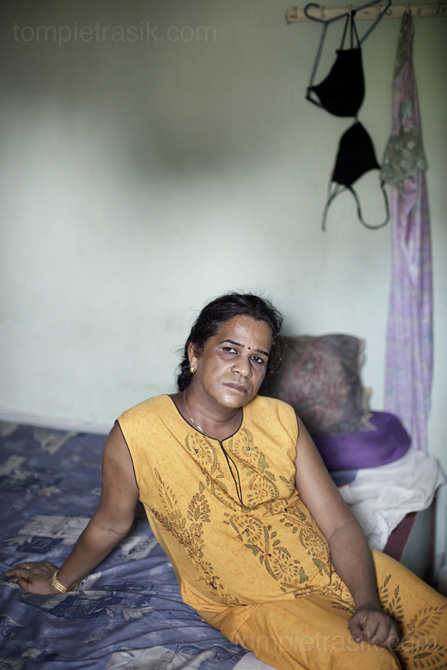 Geeta in her bedroom. Geeta is the head of an Aravani (transgender) household in Chennai. Despite a recent series of legal victories, the Aravani community, to which Geeta belongs, remain isolated from the rest of Indian society. Chennai. India ©Tom Pietrasik 2009