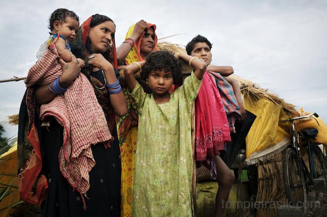 Sangita and her family.<br /> Barabanki District, Uttar Pradesh. India ©Tom Pietrasik 2007